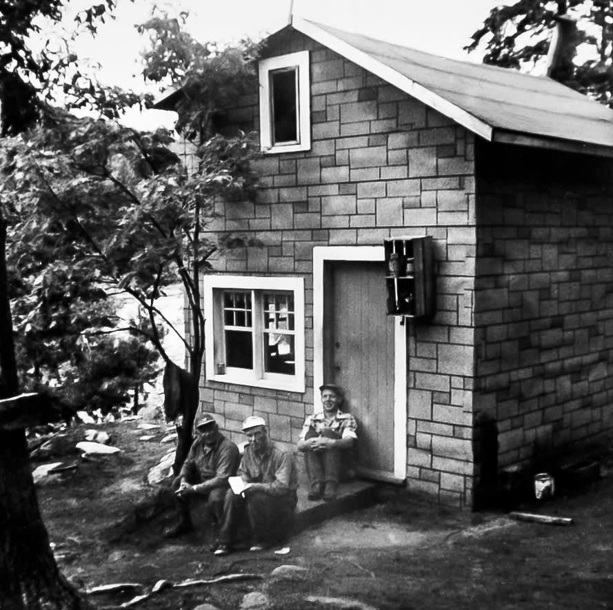 old photo of Mark and Mervyn Stubinsky sitting on porch of home