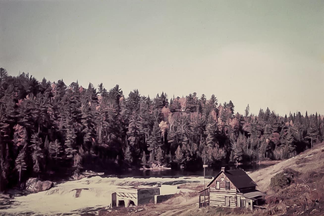 Jack Stubinsky's log house along rapids on the madawaska river