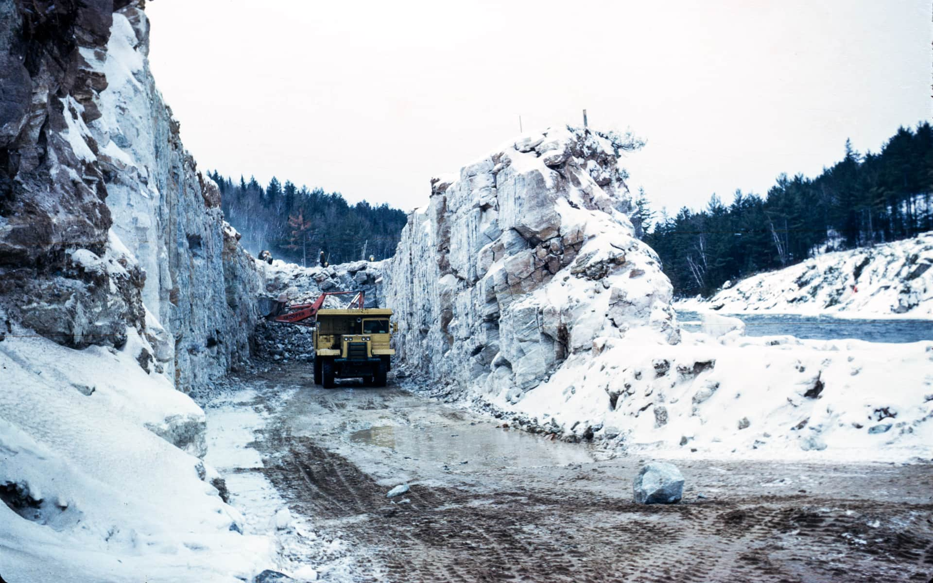 circa 1966 photo of a dump truck hauling stone while constructing the mountain chute dam on the madawaska river