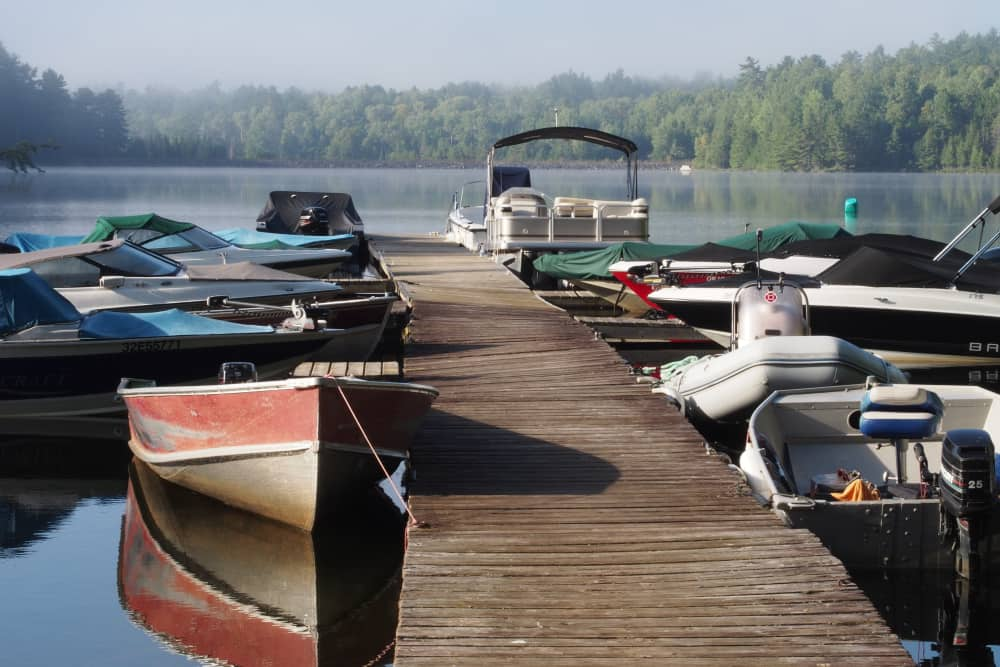 Boats at dock in the morning at Black Donald Tent and Trailer Park, near Calabogie Ontario