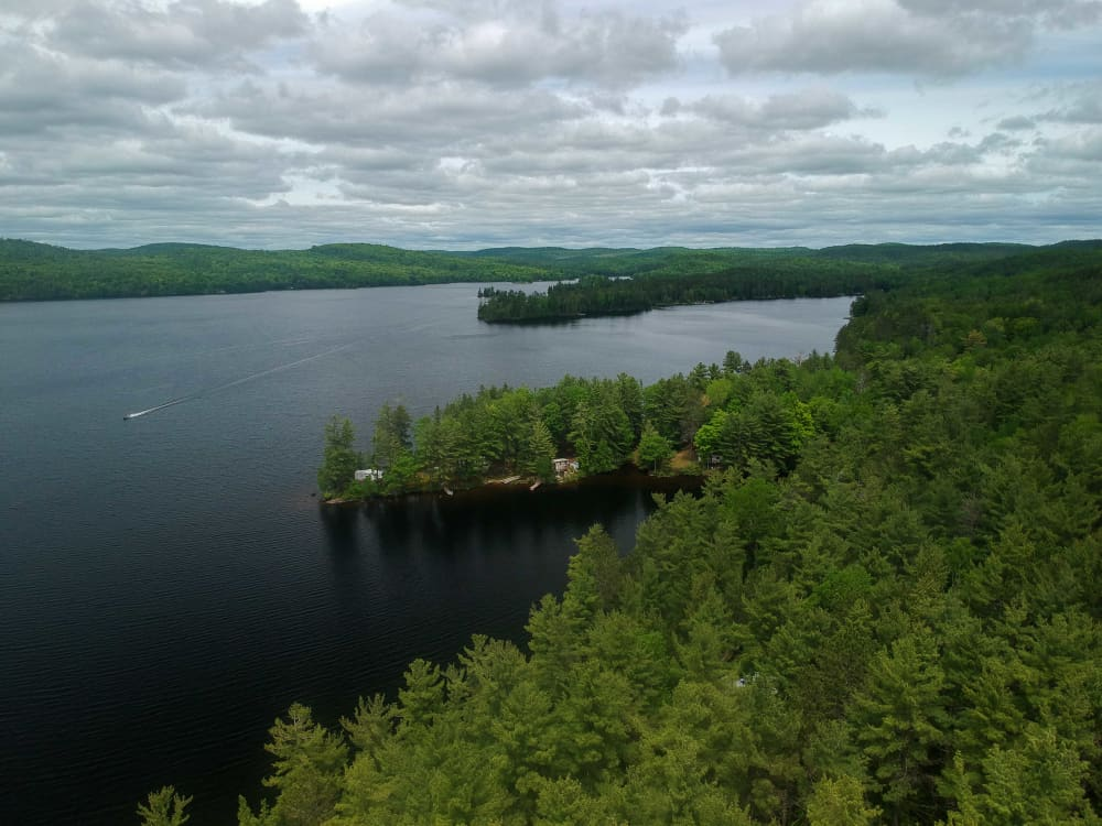 Aerial view of the lake with campsites on the point at Black Donald Tent and trailer park near calabogie