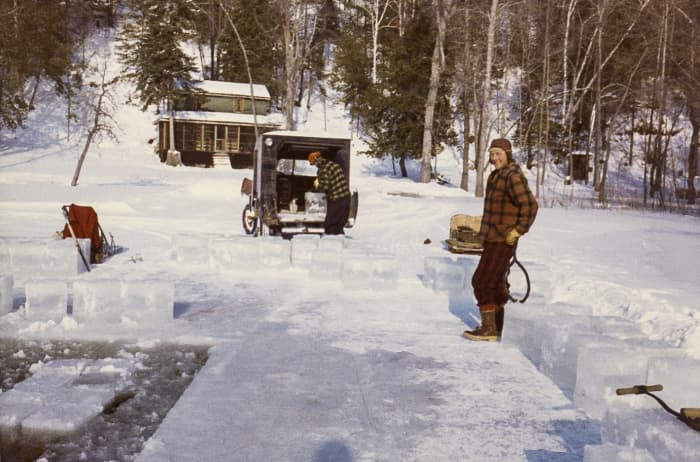 two men cutting ice blocks on the madawaska river